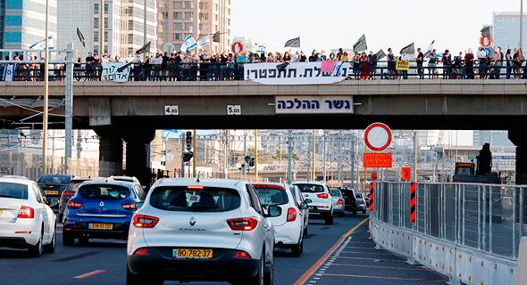 Demonstrators at Halacha Bridge, tonight