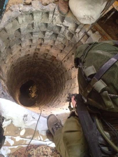 IDF soldiers looking into a terror tunnel in Gaza (Photo: IDF Spokesperson's Unit)