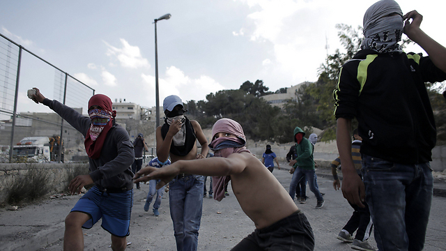 Stone-throwers in East Jerusalem: 'This is the reality they are born into' (Photo: AFP)