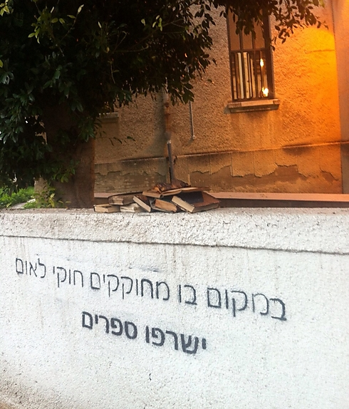 Graffiti at synagogue: 'Where Nationality Laws are passed, books will be burned'