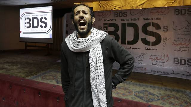 Boycott supporter at BDS event (Photo: AP)
