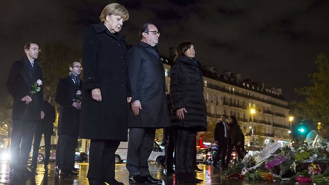 French President Francois Hollande and German Chancellor Angela Merkel honor terror victims in Paris. Europe must wake up and acknowledge that a religious war is brewing between radical Islam and the civilized, democratic and free Western world which includes Israel (Photo: AFP)