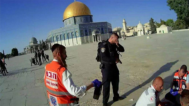 Police officer Roken Halabi mourning his friend's death at the Temple Mount