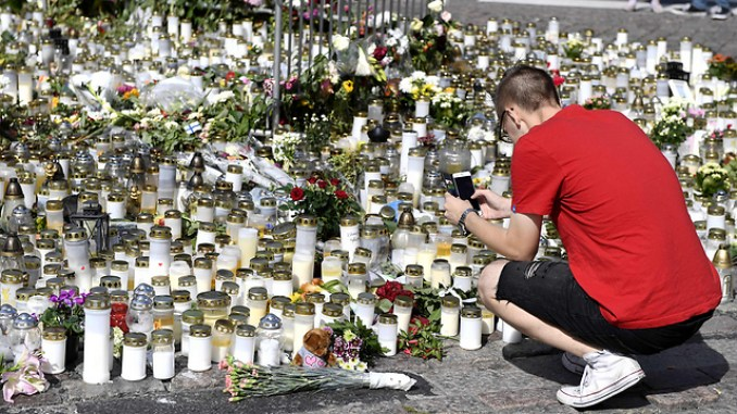 Vigil at the scene of the Aug. 18 attack in Turku, Finland (Photo: AFP)