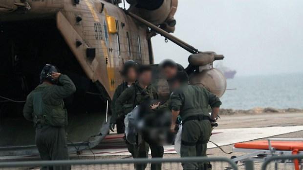 Эвакуация раненого пилота. Фото: TPS (Photo: TPS)