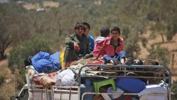 Беженцы на границе. Фото: AFP