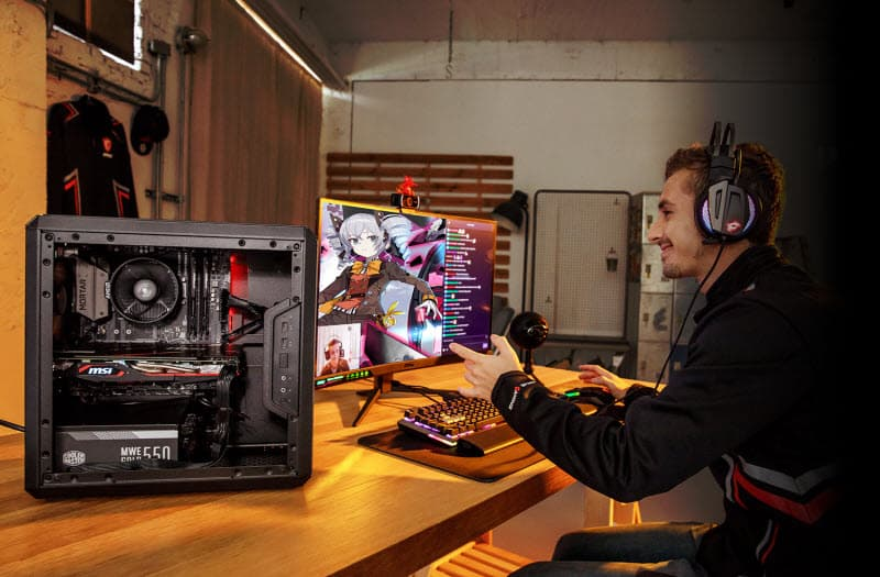 a man playing games with a complete MSI setup