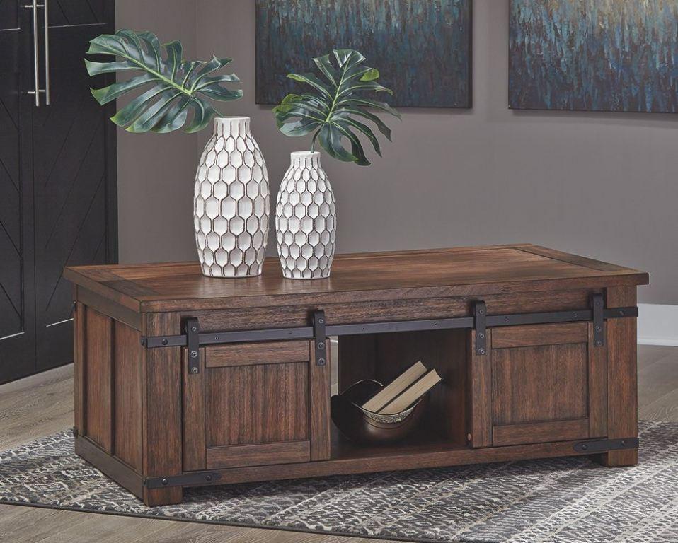 budmore brown coffee table w barn doors