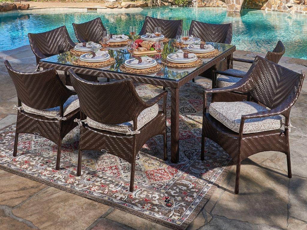 martinique java brown outdoor herringbone wicker 9 pc dining set with arm chairs and a 60 in square glass top dining table