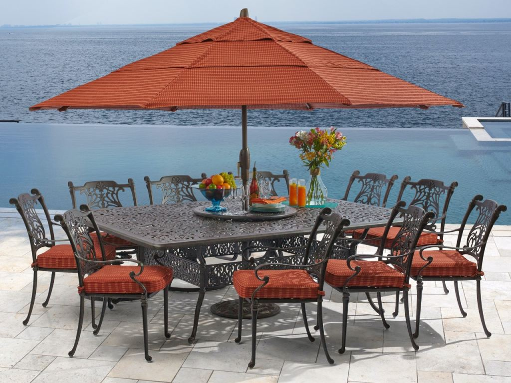 naples aged bronze cast aluminum 11 pc dining set with 90 x 64 in dining table