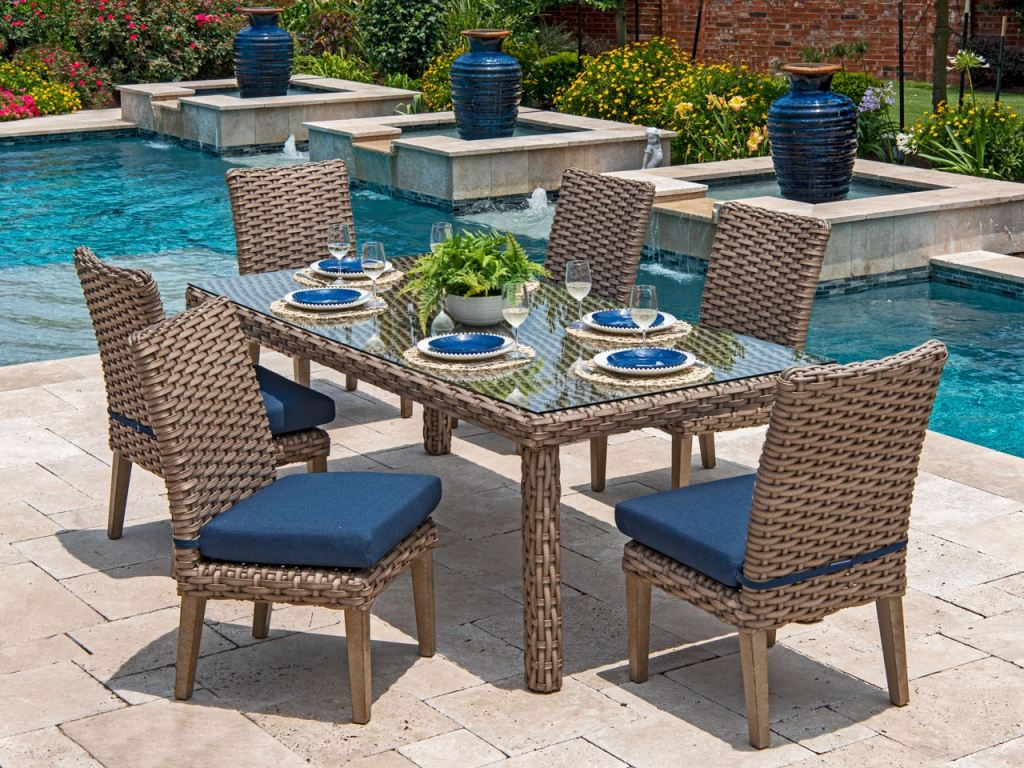 siesta aged teak outdoor wicker 7 pc indigo cushion side chair dining set with 84 x 40 in dining table
