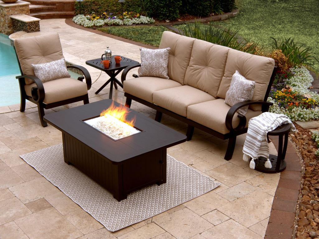 solstice aged bronze aluminum and flagship stone cushion 3 pc sofa group with 58 x 36 in lp fire pit coffee table