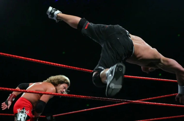 John Cena is thrown out of the ring by Edge Lita during the WWE RAW Superslam event at Acer Arena, Homebush Stadium in Sydney on August 4, 2006. (Photo by Don Arnold/WireImage)