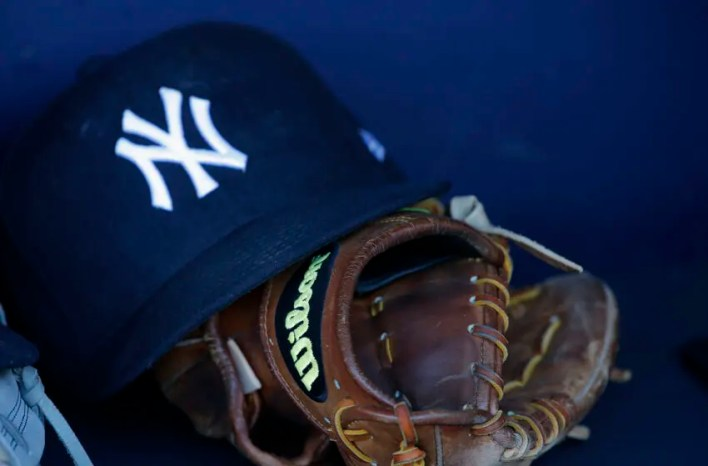 NEW YORK, NY - MAY 03: The Wilson glove and New Era cap of Chase Headley #12 of the New York Yankees in the dugoit before a game against the Toronto Blue Jays at Yankee Stadium on May 3, 2017 in New York City. (Photo by Rich Schultz/Getty Images)