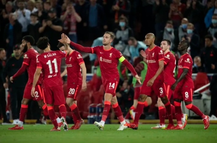 LIVERPOOL, ENGLAND - SEPTEMBER 15: Jordan Henderson of Liverpool celebrates scoring their third and winning goal during the UEFA Champions League group B match between Liverpool FC and AC Milan at Anfield on September 15, 2021 in Liverpool, United Kingdom. (Photo by Visionhaus/Getty Images)