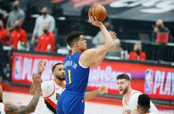 May 27, 2021; Portland, Oregon, USA; Denver Nuggets small forward Michael Porter Jr. (1) shoots the ball during the first half of game three in the first round of the 2021 NBA Playoffs at Moda Center. Mandatory Credit: Soobum Im-USA TODAY Sports