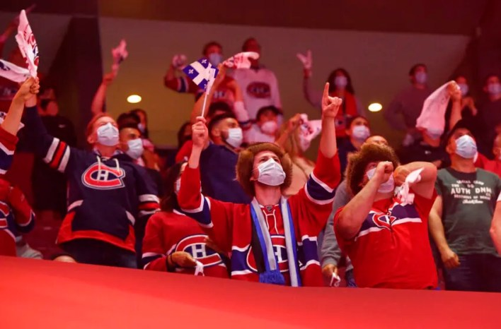 Montreal Canadiens fans react after a goal scored by Montreal Canadiens defenseman Shea Weber (not pictured) during the first period in game six of the 2021 Stanley Cup Semifinals against the Vegas Golden Knights at the Bell Centre. Mandatory Credit: Eric Bolte-USA TODAY Sports