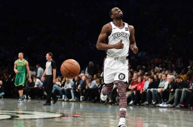 NEW YORK, NEW YORK - NOVEMBER 29: Theo Pinson # 1 of the Brooklyn Nets reacts to a call during the second half of his game against the Boston Celtics at the Barclays Center on November 29, 2019 in New York City.  NOTE TO THE USER: The user expressly acknowledges and accepts that, by downloading and / or using this Photograph, the user accepts the terms and conditions of the Getty Images License Agreement.  (Photo by Emilee Chinn / Getty Images)
