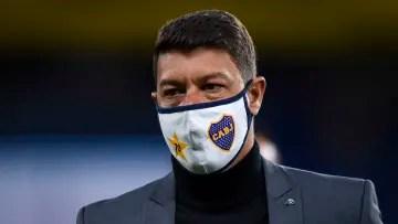Battaglia in suit for Boca Juniors' official coaching debut.