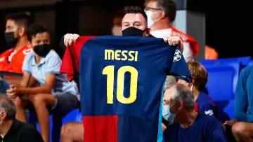 A man showing a Messi shirt