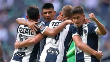 Rayados de Monterrey players celebrate a goal.