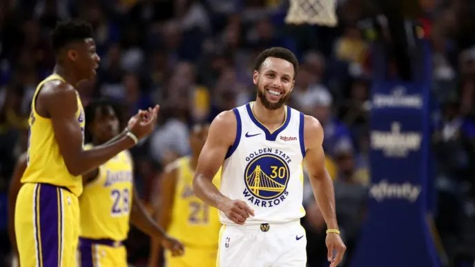 SAN FRANCISCO, CALIFORNIA - OCTOBER 18: Stephen Curry #30 of the Golden State Warriors laughs after he is fouled by Kostas Antetokounmpo #37 of the Los Angeles Lakers at Chase Center on October 18, 2019 in San Francisco, California. NOTE TO USER: User expressly acknowledges and agrees that, by downloading and or using this photograph, User is consenting to the terms and conditions of the Getty Images License Agreement. (Photo by Ezra Shaw/Getty Images)