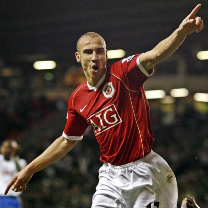 Manchester United's Henrik Larsson postu...