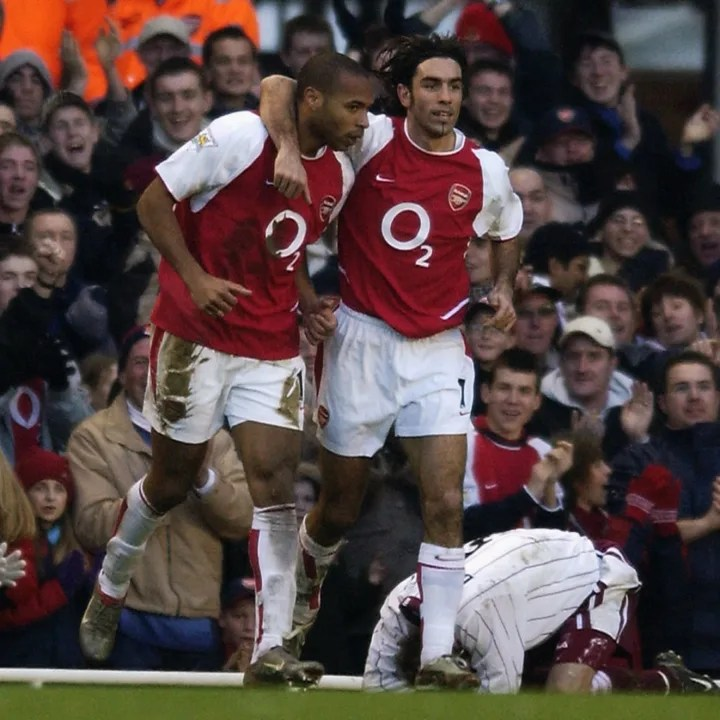 Thierry Henry of Arsenal celebrates scoring a goal with team-mate Robert Pires