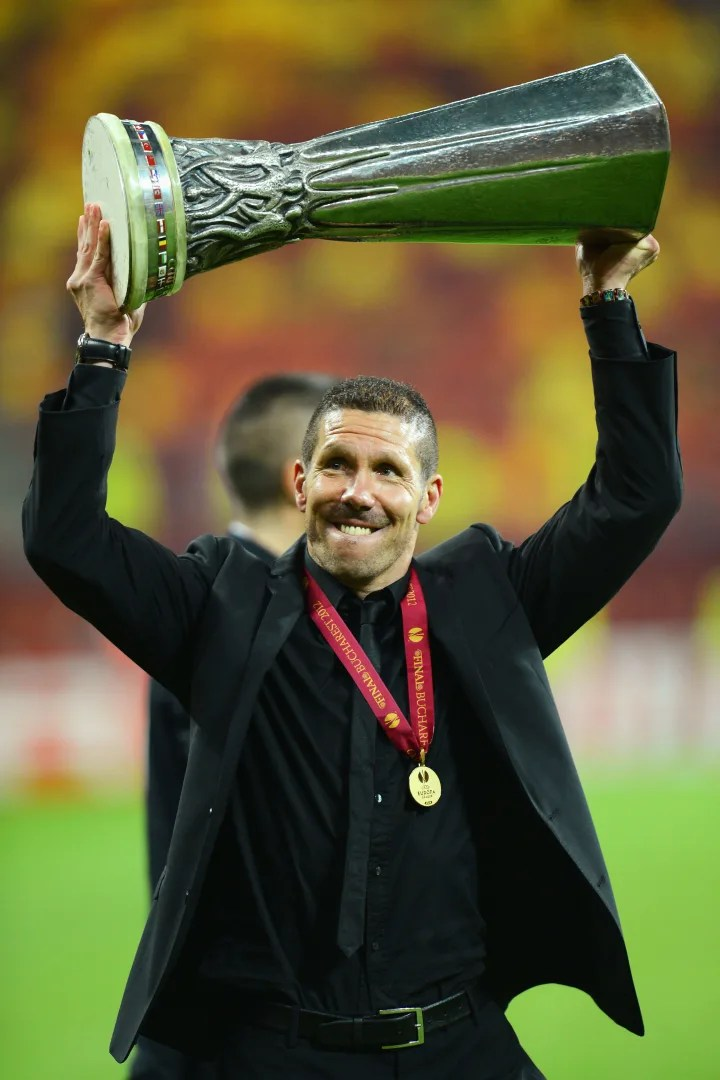 Simeone holds the first of the two Europa League trophies he would win as Atlético de Madrid coach