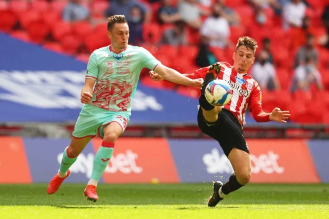 Connor Roberts battles for possession