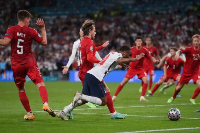 England were awarded a penalty after a challenge from Raheem Sterling from Joakim Maehle