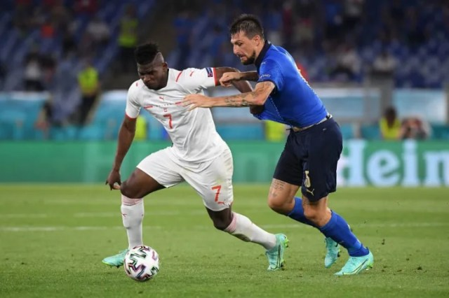Breel Embolo looks to hold of a challenge