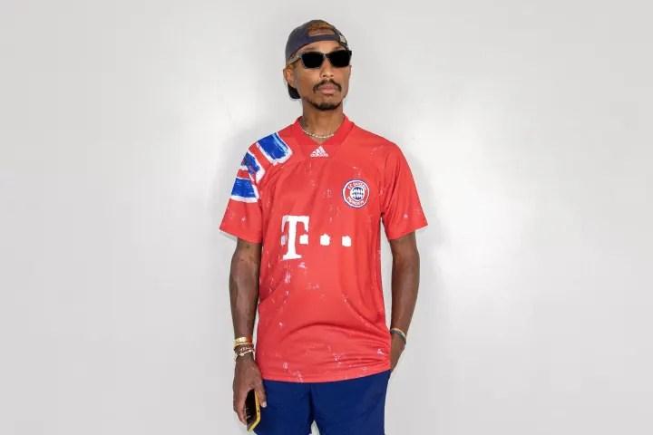 Pharrell models the shirt he helped design