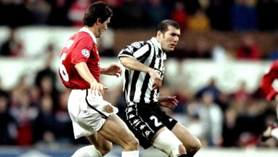 7 Apr 1999: Zinedine Zidane of Juventus is watched by Roy Keane of Manchester United in the UEFA Champions League semi-final first leg match at Old Trafford in Manchester, England. The game ended 1-1. \ Mandatory Credit: Shaun Botterill /Allsport
