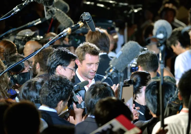 Hugh Jackman (C) gives a televison interview at the Japanese premiere of 'The Wolverine' in Tokyo on August 28, 2013