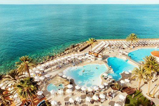 Sunwing Arguineguín Seafront - Ett poolområde med svårslagen utsikt.