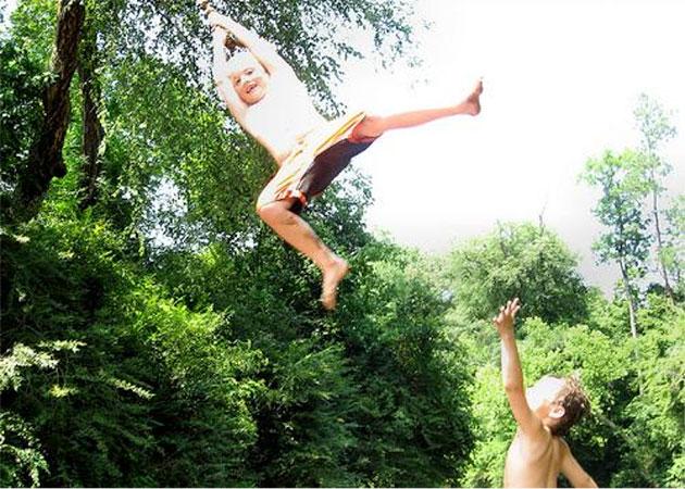 Boy on rope swing