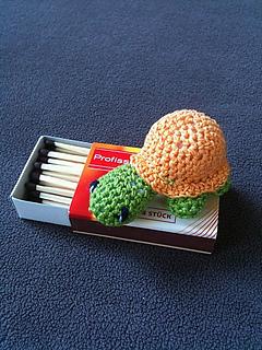 Tiny crochet turtle toy.