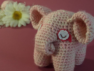An adorable crocheted elephant toy.