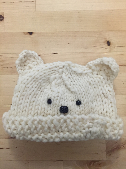 Baby bear beanie with the brim folded up.