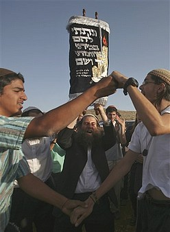Settlers dedicate a Torah scroll in the West Bank outpost of Maoz Esther, which has been dismantled and rebuilt several times in recent weeks