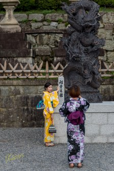 Portrait of a tourist girl taking photo of her friend, both dressed in Yukata, very common sight in Kyomizu-Dera Temple, Kyoto, Japan