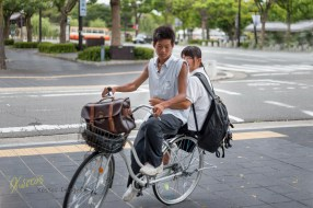 This couple turned around their bike in order to take a better look at me, or to pose for me, I'm not sure. What I know is that I love this photo and mostly I really like the hidden smile of the girl. Himeji, Japan.