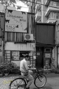 """I deliberately, converted this photo into black and white to give the sense of """"old times"""". The bicycle and the stores behind it sure give the impression that this photo is from another century. Although it was shot a few months ago during my amazing trip in Kyoto, Japan."""