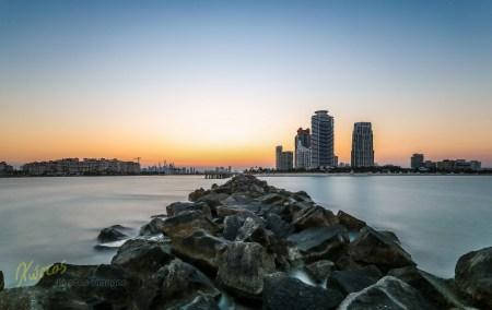 Miami South Pointe Pier. Rock platform long exposure at sunset