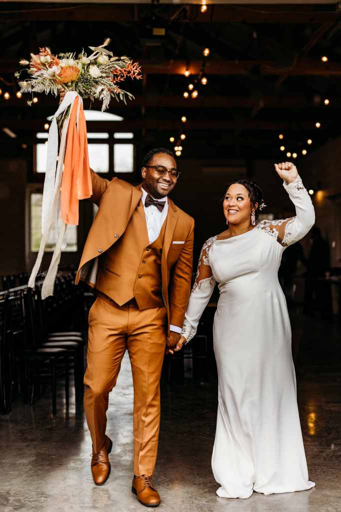 Couples celebrates their wedding in photograph by cheering together