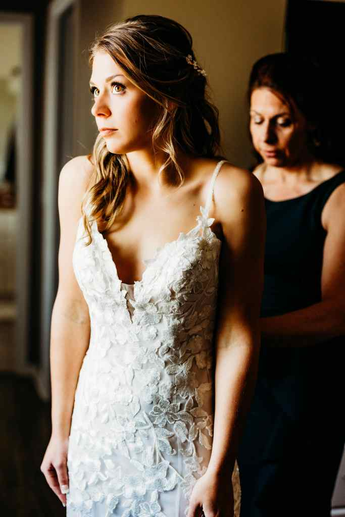 Mother hugs daughter in emotional wedding photography