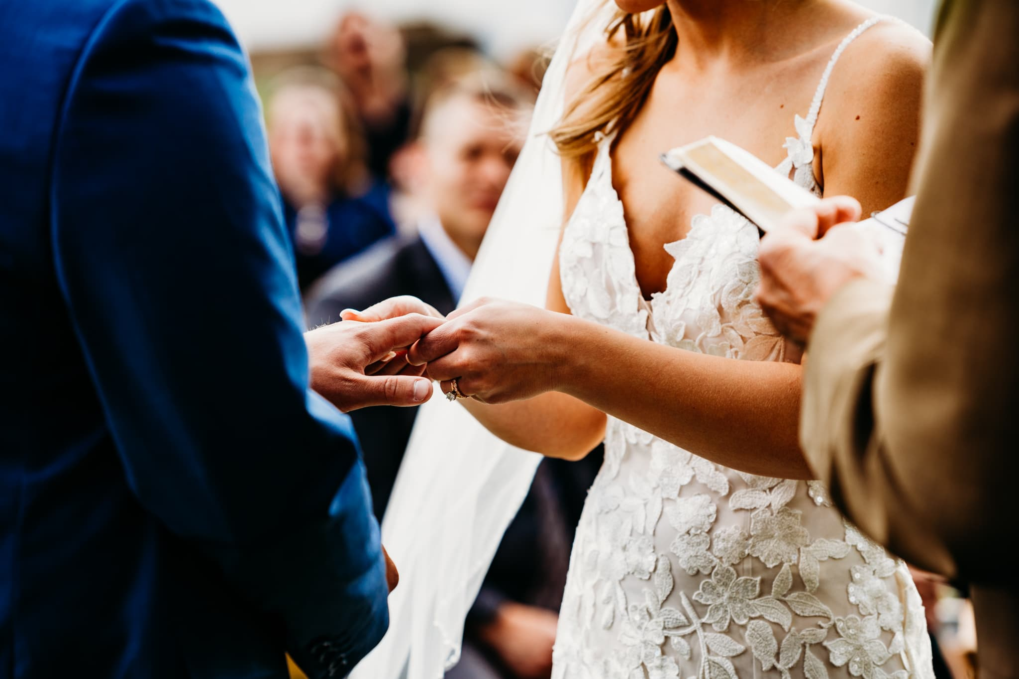 Bride and groom exchange rings at their wedding at schroeder farm