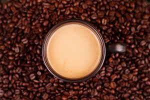 Coffee on whole beans stock photo