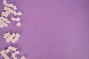 Cube sugar on purple background stock photo